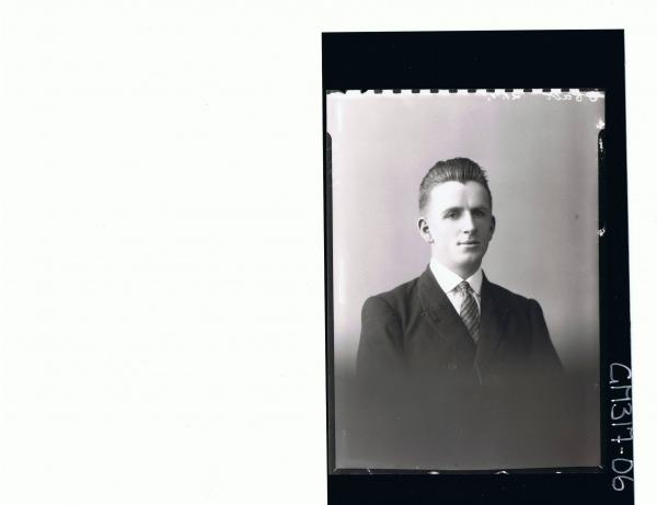 H/S Portrait of young man wearing shirt, tie and jacket; 'McCullock'