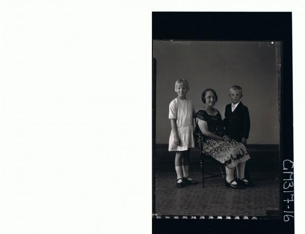 F/L Portrait of woman seated wearing 3/4 length patterned dress, girl standing wearing short dress, boy standing 'Moore'