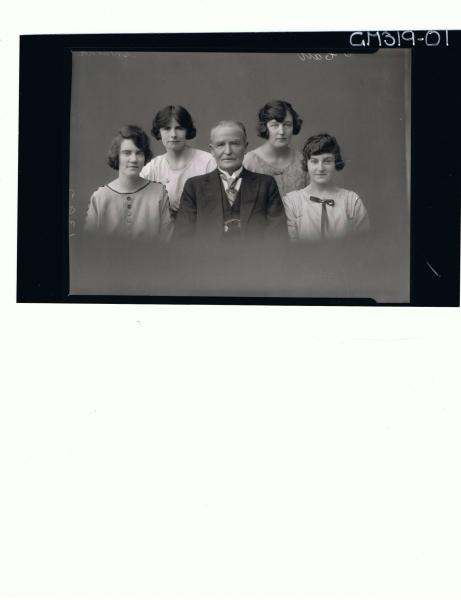 H/S Portrait of man wearing three piece suit, four young women wearing day dress 'Shearne'