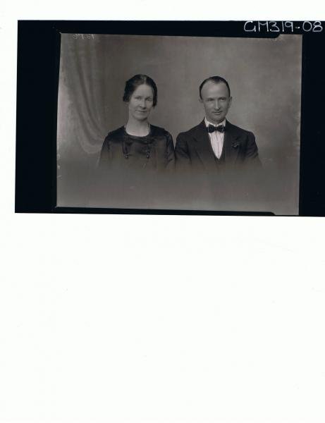 H/S Portrait of man wearing three piece suit and bow tie, woman wearing satin dress 'Scribbins'