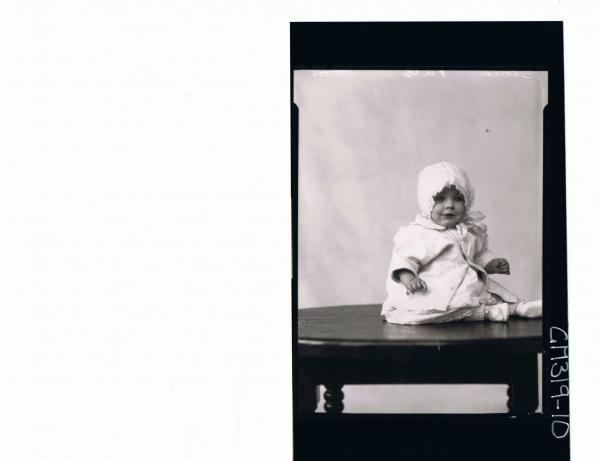 F/L Portrait of baby seated on table, wearing lace dress, jacket and bonnet 'Stack'