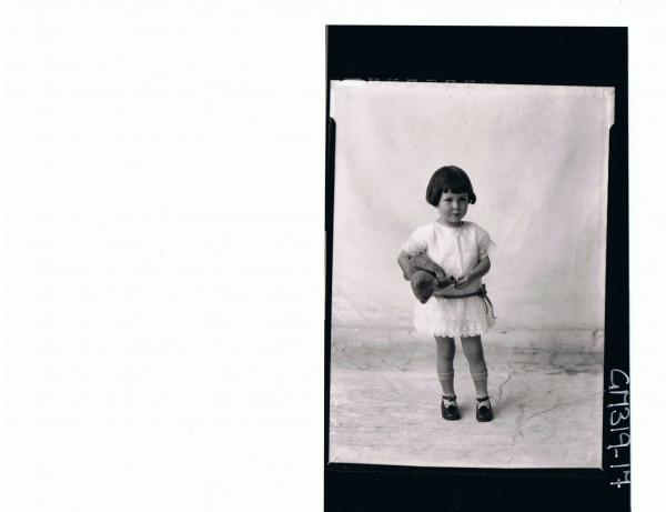 F/L Portrait of girl child standing wearing short lace dress holding a teddy bear 'Smith'