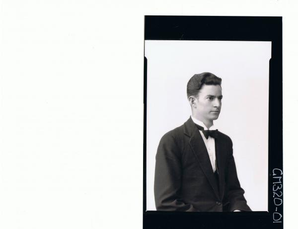 1/2 Portrait of young man wearing three piece suit, bow tie, side view; 'Stahl'