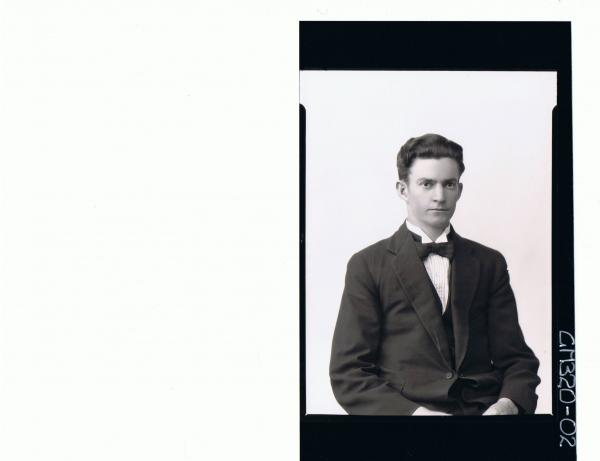 1/2 Portrait of young man wearing three piece suit, bow tie; 'Stahl'