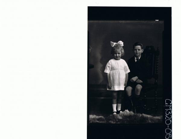 F/L Portrait of boy seated wearing school uniform, girl standing wearing short dress, ribbon in hair 'Smythe'