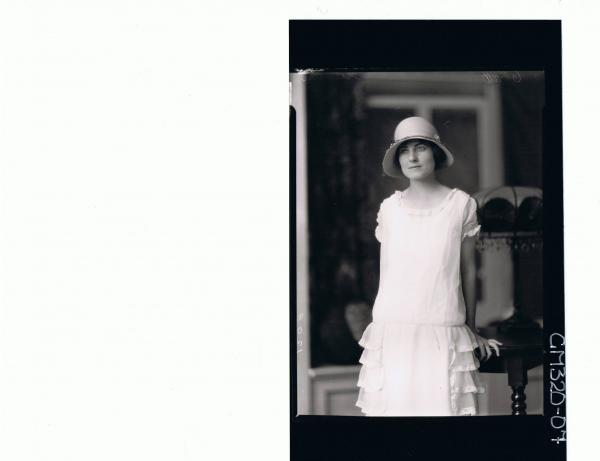 1/2 Portrait of woman standing wearing lace dress, hat 'Stevens'