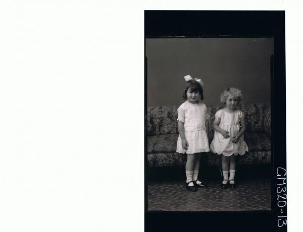 F/L Portrait of girl standing wearing short lace dress, ribbon in hair, girl standing wearing short dress 'Shocker'