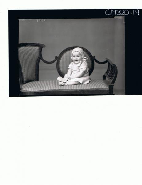 F/L Portrait of baby seated wearing knitted dress and bonnet 'Martin'