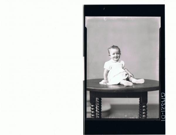 F/L Portrait of baby seated on table, wearing dress; 'Martin'