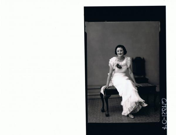 F/L Portrait of woman seated wearing long frilly evening dress; 'McFatty'