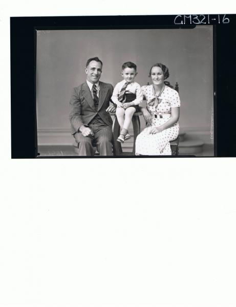 1/2 Portrait of man seated wearing 3 piece suit, woman seated wearing spotted dress,boy seated wearing shirt,tie'McCann'