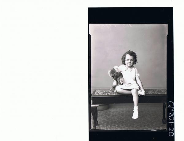 F/L Portrait of girl seated wearing short dress, holding a koala bear; 'McGowan'