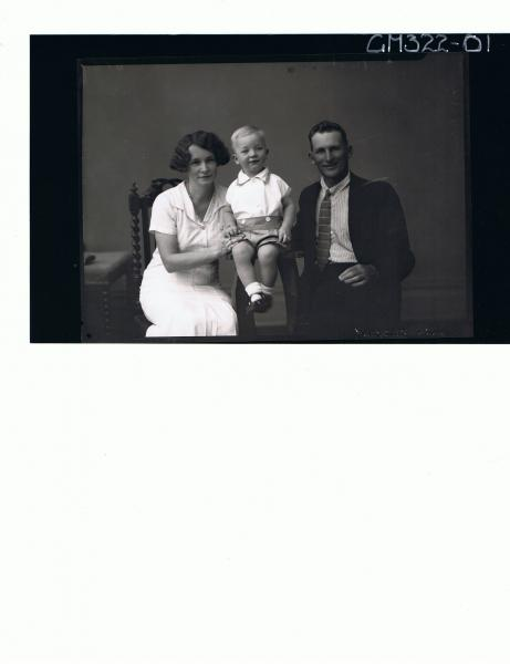 1/2 Portrait of man seated wearing suit, woman seated, boy child seated wearing shorts and shirt; 'McQuid'