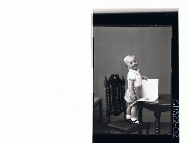 F/L Portrait of boy child standing on chair at table, wearing shorts and shirt; 'McQuoid'
