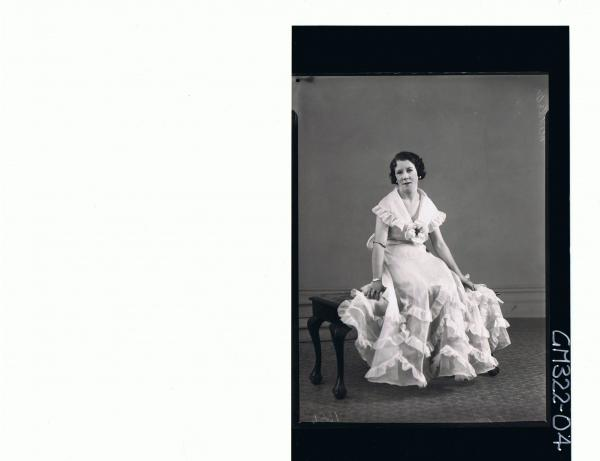 F/L Portrait of woman seated wearing long frilly evening dress; 'Middleton'