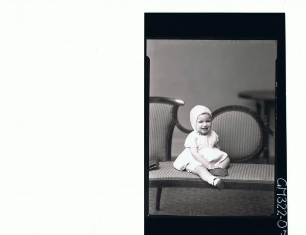 F/L Portrait of baby seated wearing dress and bonnet; 'Moylan'