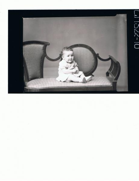 F/L Portrait of baby seated wearing short knitted dress; 'Martin'