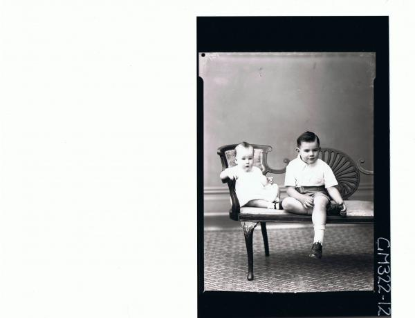 F/L Portrait of boy seated wearing shorts, shirt, baby seated wearing dress; 'Moyle'