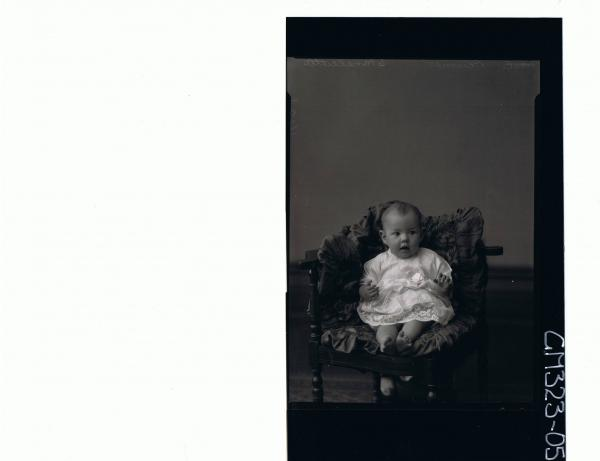F/L Portrait of baby seated wearing lace dress; 'Plumer'