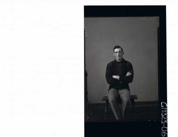 3/4 Portrait of man, seated wearing trousers, jumper; 'Thomas'