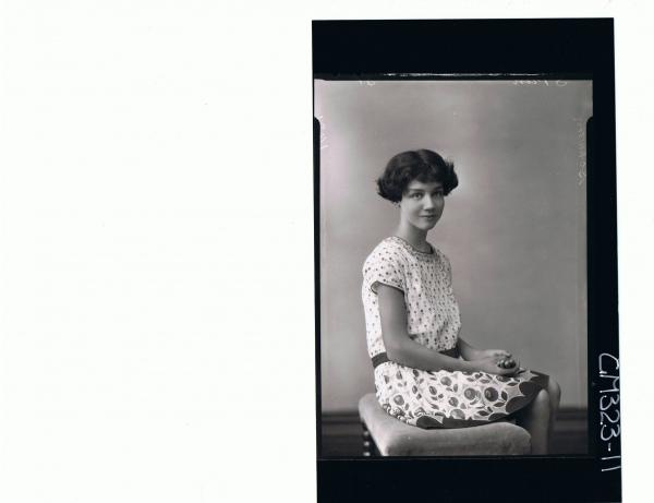 3/4 Portrait of girl seated, wearing short patterned dress, 'Schwan'