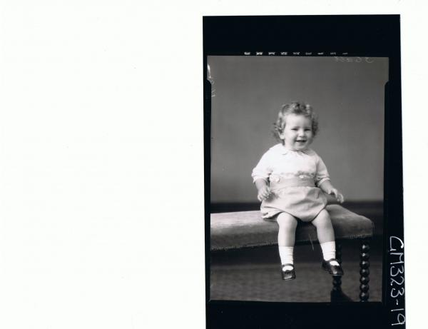 F/L Portrait of baby seated wearing shorts and shirt; 'Smith'