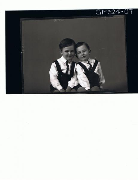 1/2 Portrait of two male children seated, wearing shirts, ties and shorts with braces; 'Lamont-Smith'