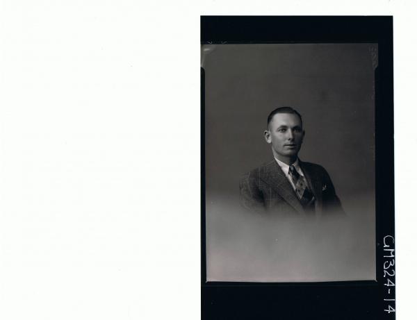 H/S Portrait of man wearing shirt, tie and jacket; 'Telic Mit'