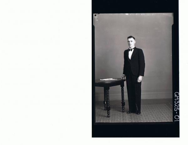 F/L Portrait of man standing wearing three piece suit, bow tie; 'Uybo'