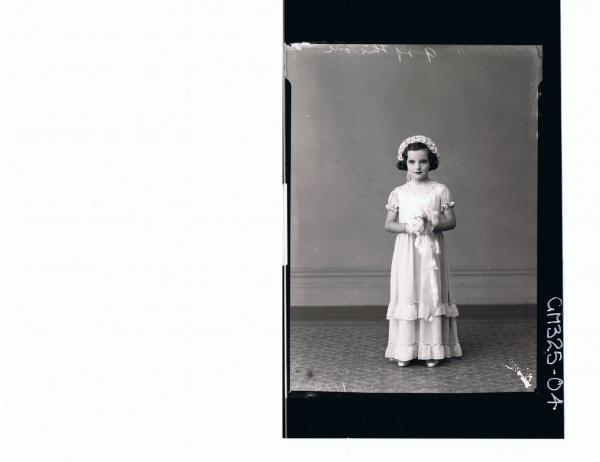 F/L Portrait of flower girl, wearing long dress holding bouquet, flowers in her hair; 'Lillis'
