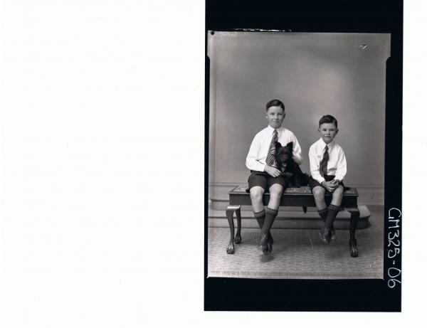 F/L Portrait of boy seated with dog, wearing shorts, tie boy seated wearing shorts, tie and shirt; 'Lyall'