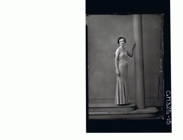 F/L Portrait of woman standing wearing long evening dress; 'Lodding'