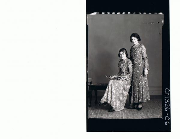 F/L Portrait of woman seated holding book, wearing long floral dress, woman standing in similar; 'Lewis'