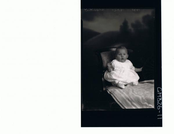 F/L Portrait of baby seated wearing embroidered dress; 'Sheppard'
