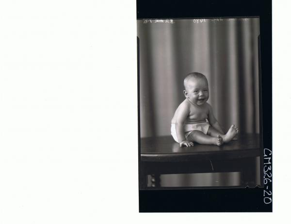 F/L Portrait of baby seated on table wearing pilchers; 'Slater'