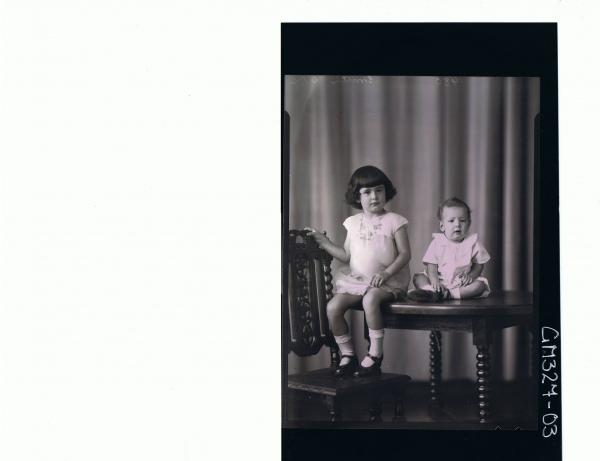 F/L Portrait of girl child seated on table wearing short dress, baby seated on table also; 'Smith'
