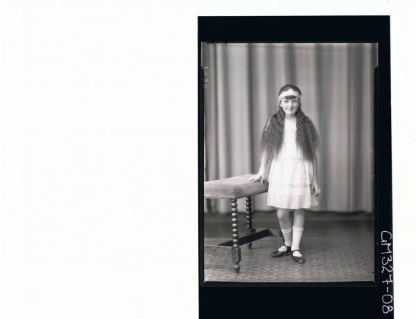 F/L Portrait of girl standing wearing short dress headband on forehead; 'Sutton'