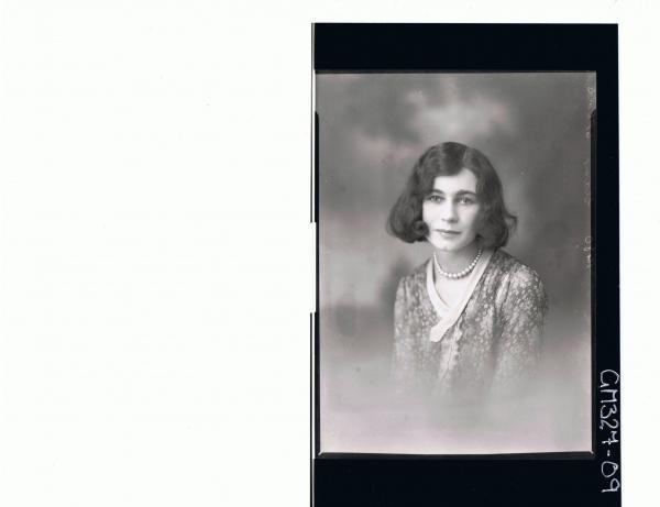 H/S Portrait of woman wearing floral dress; 'Starr'
