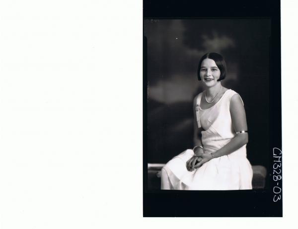 1/2 Portrait of woman seated wearing knee length dress; 'Sloan'