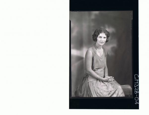 1/2 Portrait of woman seated wearing evening dress; 'Scott'