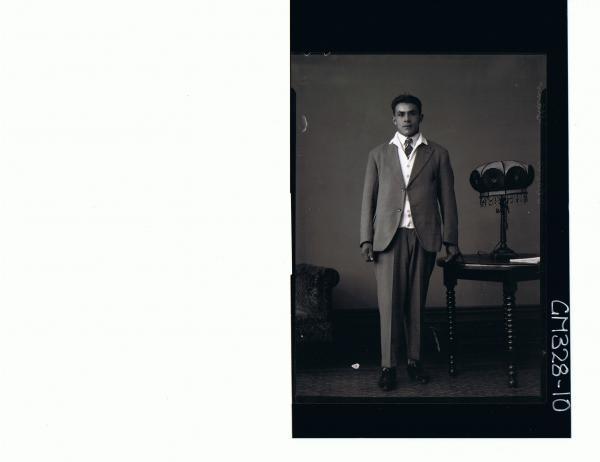F/L Portrait of man standing, wearing suit; 'Starr'