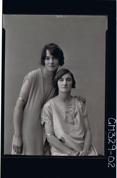 1/2 Portrait of 2 women, both wearing knee length dresses, one standing, one sitting; 'Bartlett'