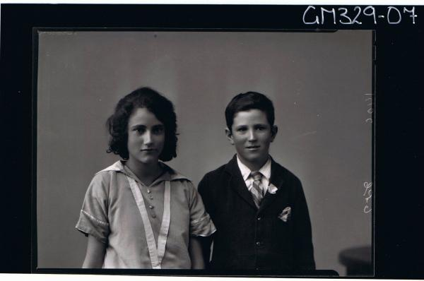1/2 Portrait of girl wearing day dress, boy wearing shirt and tie and jacket; 'Brown'