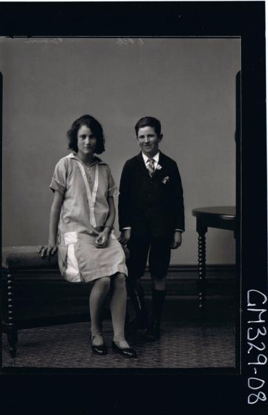 F/L Portrait of girl seated, wearing knee length dress, boy standing wearing shorts, shirt, tie and jacket; 'Brown'