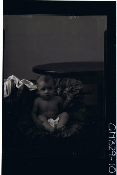 F/L Portrait of naked baby seated; 'Basetrn'