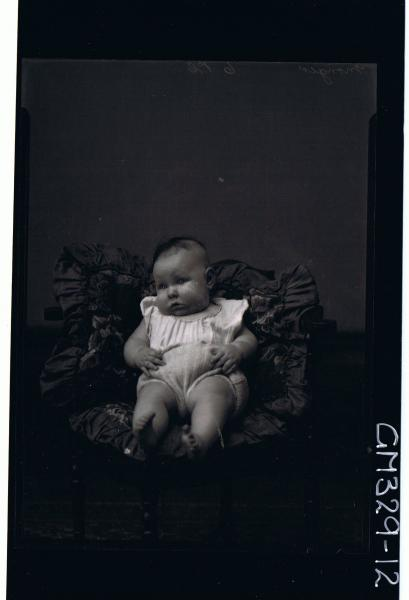 F/L Portrait of baby seated wearing knitted pants, top. 'Monger'