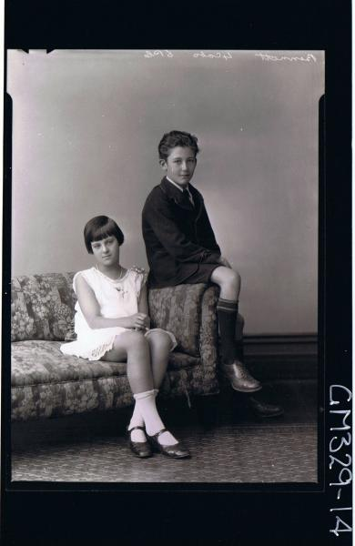 F/L Portrait of boy seated wearing short, shirt, tie, jacket, girl seated wearing knee length dress,lace trim; 'Bennett'