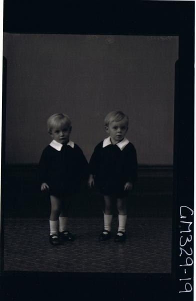 F/L Portrait of two male children, seated, both wearing shorts and shirts; 'Morris'