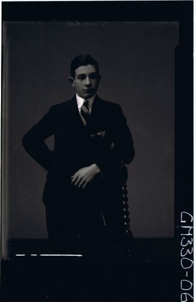 3/4 Portrait of young man standing wearing suit; 'McIvor'