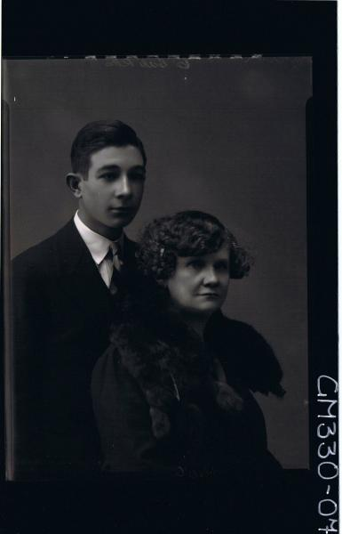 1/2 Portrait of woman wearing fur round shoulders, young man wearing suit; 'Ivor'
